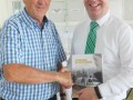 14 The author presents a copy of Guinness Down Under to Jim Daly  Irish Minister of State for Mental Health and Older People  at the Irish Fair  Auckland  11 March 2018