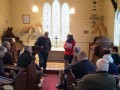 G23.1 Jane Batchelor  chair of the Burkes Pass Heritage Trust introduces the author to meeting at St Patricks church  Jared Griffith photo